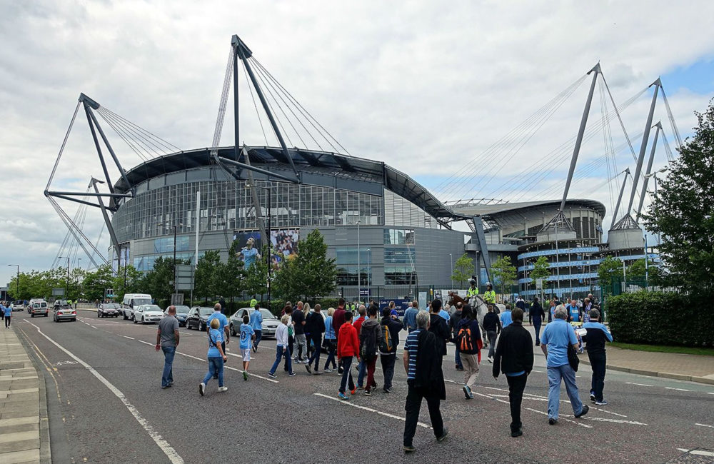 Fans walking to the Etihad Staduim